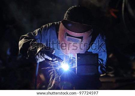 skilled working factory welder.
