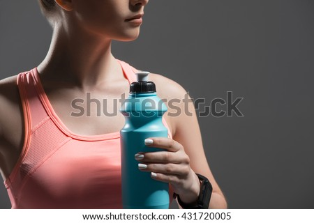 Skillful female athlete is resting after training - stock photo