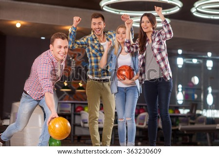 Skillful young kegling team on the competition - stock photo