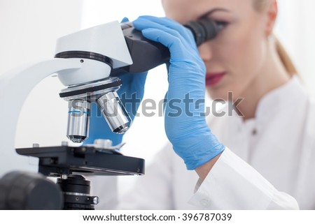 Skillful young researcher is working in lab