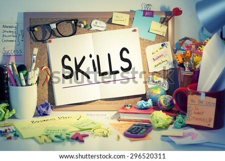 Skills note on paper pinned on bulletin board - stock photo