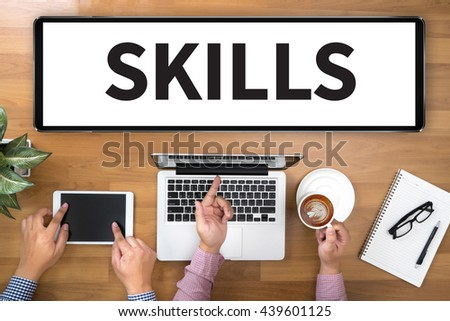 SKILLS Two Businessman working at office desk and using a digital touch screen tablet and use computer, top view - stock photo