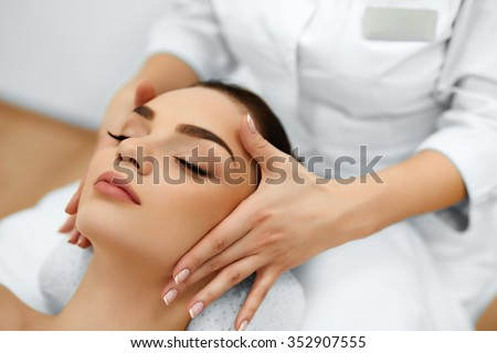 Skin And Body Care. Close-up Of A Young Woman Getting Spa Treatment At Beauty Salon. Spa Face Massage. Facial Beauty Treatment. Spa Salon. - stock photo