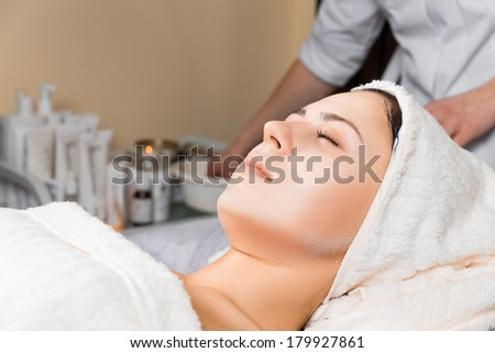 skin care, beautician after applying face mask cream