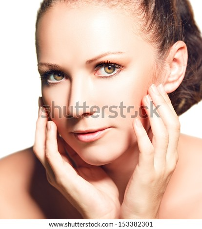 skin care. Beauty face of  young woman isolated on white background