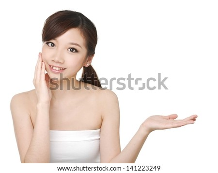 Skin care beauty woman showing empty palm with copy space for product.