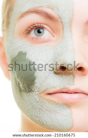 Skin care. Woman in clay mud mask on face isolated on white. Girl taking care of dry complexion. Beauty treatment.