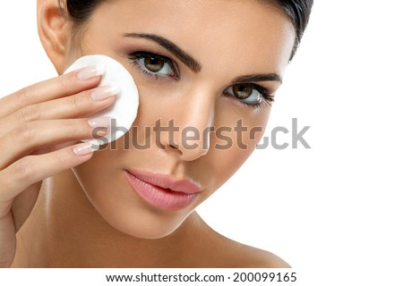skin care woman removing face makeup with cotton swab pad - skin care concept. - stock photo