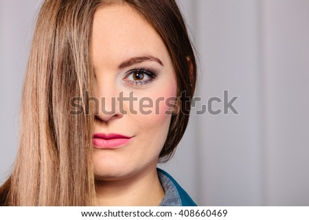 Skincare and cosmetics. Young woman with natural makeup hair cover face eye. - stock photo