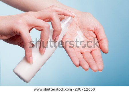 Skincare. Closeup of female hands. Young woman girl taking care of her dry hands palms applying moisturizing cream. Beauty treatment. - stock photo