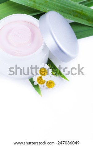 Skincare creams with camomile extract, natural organic cosmetics - stock photo