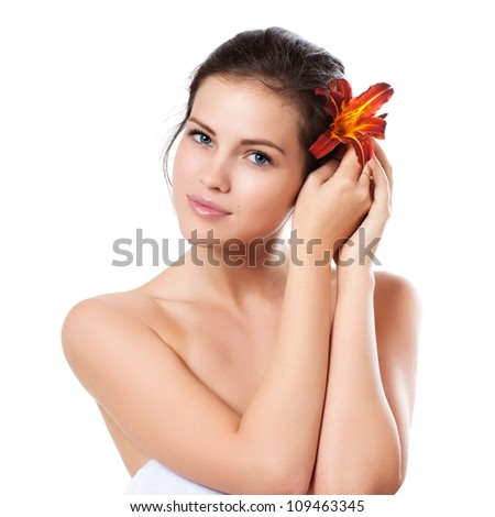 Skincare of young beautiful woman face with fresh flower over white background - stock photo