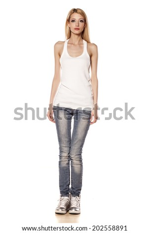 skinny blonde girl standing on white background - stock photo