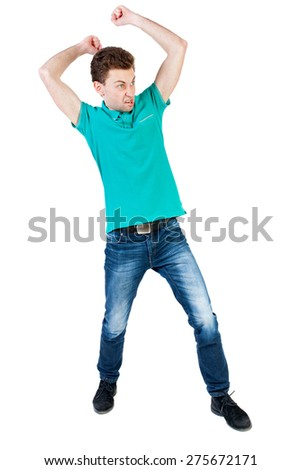 skinny guy funny fights waving his arms and legs. Isolated over white background. Funny guy clumsily boxing. Angry man with fists brasaetsya to someone else - stock photo