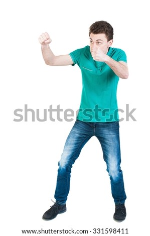 skinny guy funny fights waving his arms and legs. Isolated over white background. Funny guy clumsily boxing. A young boy learns to box. - stock photo