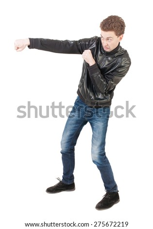 skinny guy funny fights waving his arms and legs. Isolated over white background. Man shoots with his right hand. - stock photo