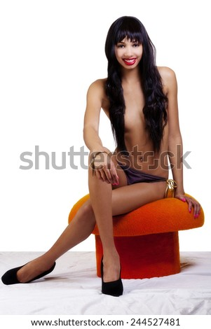 Skinny Topless African American Woman Sitting Stool - stock photo