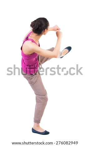 skinny woman funny fights waving his arms and legs. Rear view people collection.  backside view of person.  Isolated over white background. African American woman in sparring. - stock photo
