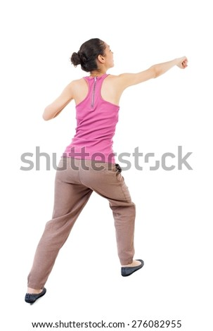 skinny woman funny fights waving his arms and legs. Rear view people collection.  backside view of person.  Isolated over white background. African-American woman punches - stock photo