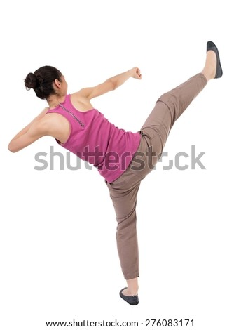 skinny woman funny fights waving his arms and legs. Rear view people collection.  backside view of person.  Isolated over white background. African-American woman has a leg up - stock photo