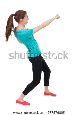 skinny woman funny fights waving his arms and legs. Rear view people collection.  backside view of person.  Isolated over white background. Girl in sportswear brushes hand. - stock photo