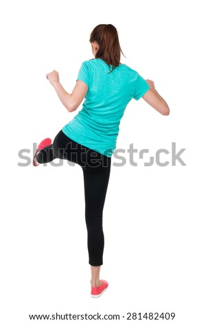 skinny woman funny fights waving his arms and legs. Rear view people collection.  backside view of person.  Isolated over white background. Athlete holds with his left foot. - stock photo