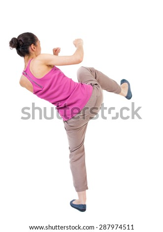 skinny woman funny fights waving his arms and legs. Rear view people collection.  backside view of person.  Isolated over white background. African-American woman kick foot. - stock photo