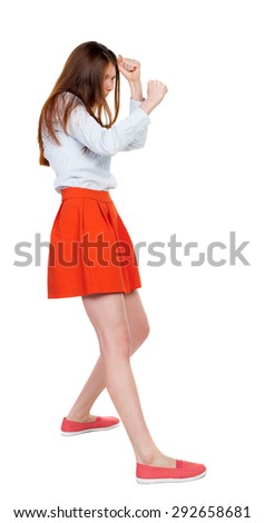 skinny woman funny fights waving his arms and legs. Rear view people collection.  backside view of person.  Isolated over white background. girl in red short skirt fights and waving his arms. - stock photo