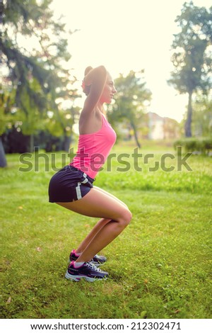 skinny woman in park, doing squats and running at sunset. fitness training and workout - stock photo