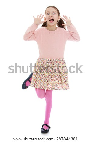 Skinny young girl yells while standing on one leg-isolated on white background - stock photo
