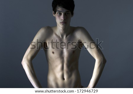 Skinny young man posing fashion, anorexic look, slim body - stock photo