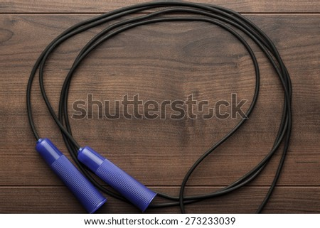 skipping rope for an exercise on the table - stock photo