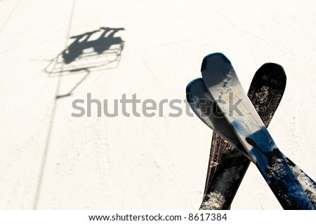 skis and shadow on ski lift - stock photo