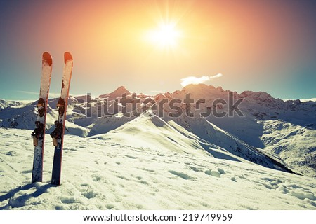 Skis in snow at Mountains - stock photo