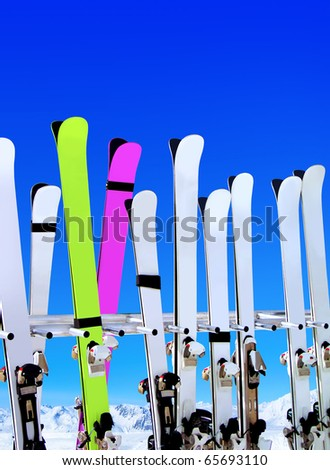 skis on snow covered place in winter with mountains in the distance - stock photo