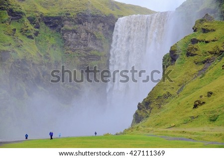 SKOGAFOSS, ICELAND - SEPTEMBER 08: Skogafoss Waterfalls in Iceland on September 08, 2015. One of the most beautiful waterfalls in Iceland.