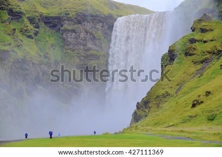 SKOGAFOSS, ICELAND - SEPTEMBER 08: Skogafoss Waterfalls in Iceland on September 08, 2015. One of the most beautiful waterfalls in Iceland. - stock photo