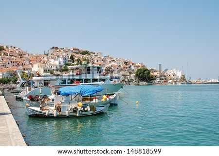 SKOPELOS, GREECE - JUNE 24: Boats moored in the harbour at Skopelos Town on June 24, 2013 on Skopelos island, Greece. The island was the location for the 2008 film Mamma Mia.  - stock photo