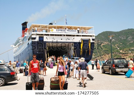SKOPELOS, GREECE - JUNE 24, 2013: Hellenic Seaways ferry Express Pegasus disembarks passengers at Skopelos Town on the Greek island of Skopelos. The island was the location for the film Mamma Mia! - stock photo