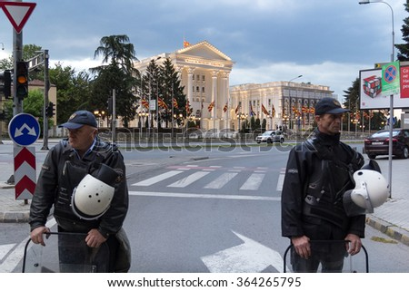SKOPJE, MACEDONIA - MAY 11, 2015: Street protest against prime minister Nikola Gruevski's government. Two policemen standing on the street in front of National Archaeological Museum.