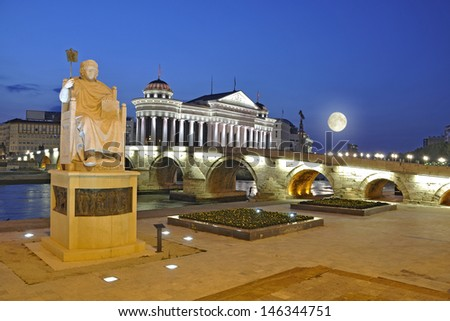 Skopje night scene at dawn - Macedonian museum of Archeology with full moon - stock photo