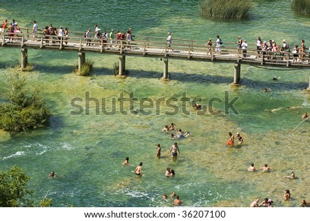 Skradinski Buk - people cooling down below world famous waterfall on the Krka river, Krka national park, Croatia, summer 2009 - stock photo