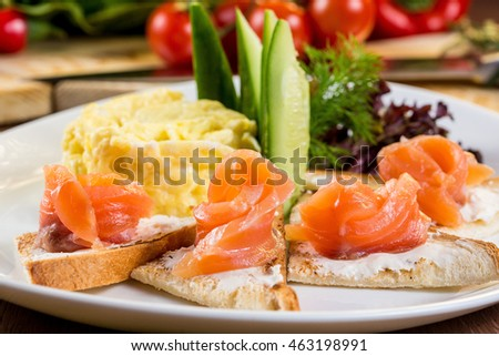 Skrembl of eggs. Toasts with cream cheese and salted salmon
