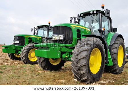Skrzelew - October 09: Presentation of the John Deere Tractors (6630 and 7530 series) during the XIII Days of Corn on October 09, 2011 in Skrzelew, Poland. - stock photo