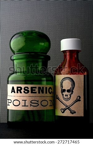 skull and bones and poison bottle. - stock photo