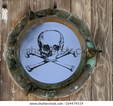 Skull and Crossbones On Blue Background As Seen Through A Rustic Old Porthole - stock photo