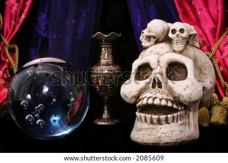 Skull and Crystal Ball on Black Background - stock photo