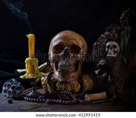 Skull and ritual on dark night with candle extinguish / Image Still life   - stock photo