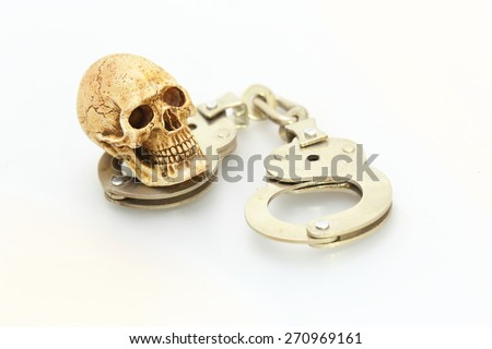 Skull and shackle - stock photo