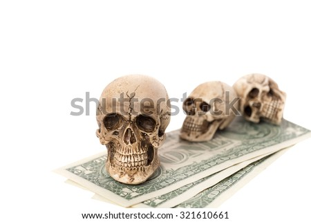 Skull and US dollar banknote isolated on white,hard work less income concept. - stock photo